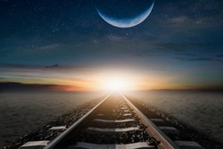 The train cuts through the desert in the mornings, with a half-moon, to be beautifully laid.