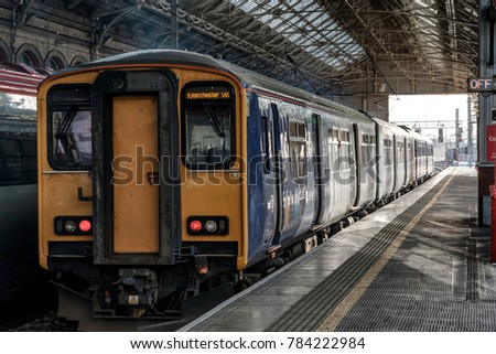 The train standing at the platform is about to leave for Manchester