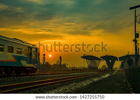 The train was moving towards the station on a thin misty morning, so the train seemed less focused and somewhat blurred