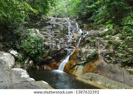 The tranquility of Kampong Mukut Waterfall, Tioman Island, Malaysia. Stock photo ©