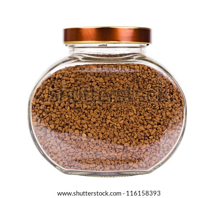 The transparent glass jar with a brown cover and filled by a dried freeze coffee isolated