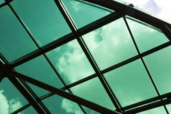 The transparent roof of tinted green glass