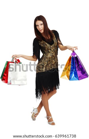 the trendy woman or rather girl smiling happy , colorful packaging or bags isolated on a white Studio background #639961738