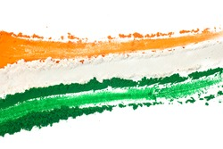 The tricolor of the Indian national flag painted with dye powder and isolated on white.