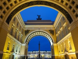 The Tripartite Triumphal Arch of General Staff Building (part of the Hermitage Museum), the Alexander Column and the State Hermitage Museum (Winter Palace) at before dawn in Saint Petersburg, Russia.