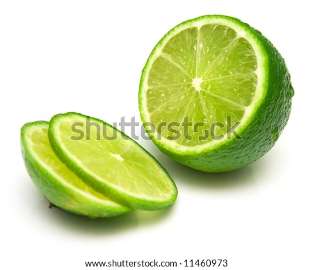 The tropical fruit known as lime, cut across. The image is isolated on white. Shallow DOF. Close-up.