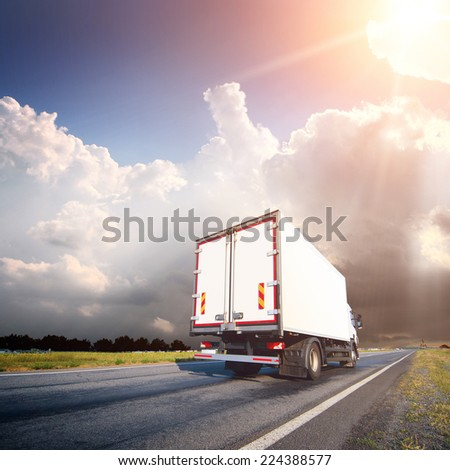 The truck with freight moving fast #224388577