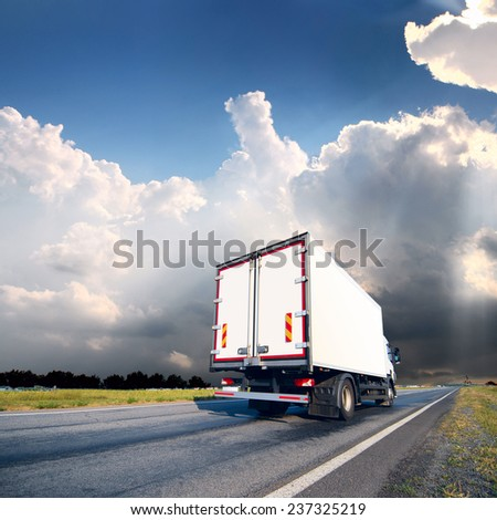 The truck with freight moving fast #237325219