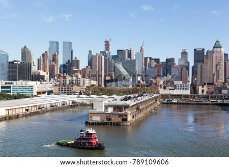 The tugboat passing by Manhattan Midtown piers (New York City). #789109606