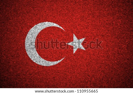 The Turkish flag painted on a cork board.