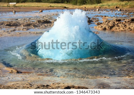 The turquoise blue boiling bubble of Strokkur Geyser In Iceland before eruption. Gold Circle. Iceland.
