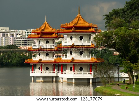 The Twin Pagoda at the Chinese Garden of Singapore against a cloudy sky