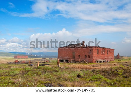 The two abandoned brick building in the tundra. Abandoned building on the prison-delivery inactive mine for the extraction of siltstone.