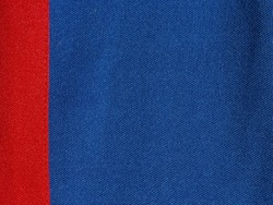 The two-colour texture of the synthetic fabric is blue and red. Nylon texture. Embossed synthetic fibre fabric texture. Abstract fabric background close-up. Waterproof synthetic fabric.