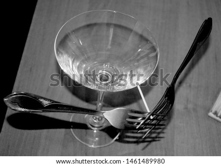 The two forks on the match are in balance on the edge of the martini glass. Equilibrium. The center of gravity.