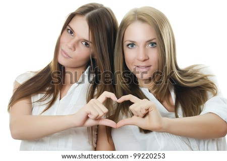 The two girl-friends isolated on white  background
