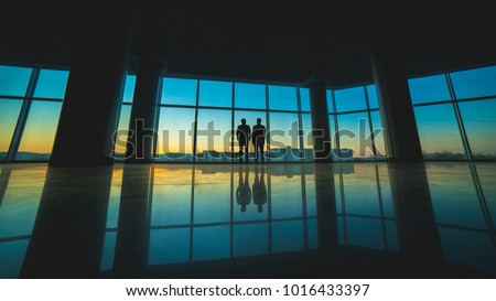 The two men stand on the panoramic window background #1016433397