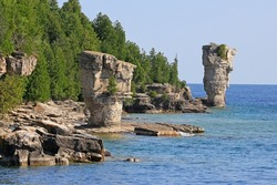 The two rock pillars rise from the waters of Georgian Bay on Flowerpot island in Fathom Five National Marine Park, Lake Huron, Canada