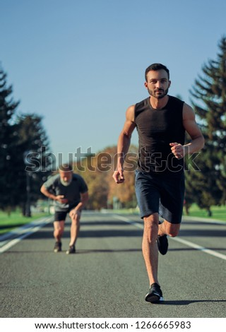 The two sportsmen jogging on the road