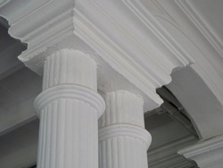 the two white vintage pillars