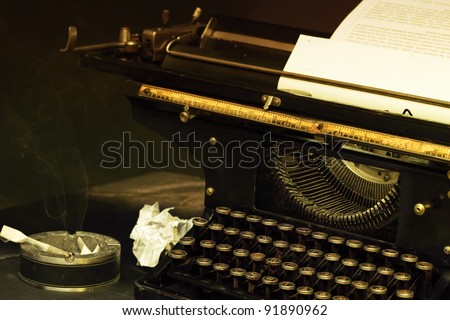 The typewriter image in style retro with a cigarets and smoke