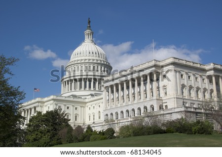 The U.S. Capitol Building on a Bright Spring Day Against a Bright Blue Sky With a Few Puffy White Clouds