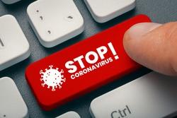 The UK Variant of mutated corona virus B117 hit the world. Pandemic Coronavirus concept. Close up finger pressing red computer key with stop coronavirus word and illustration.
