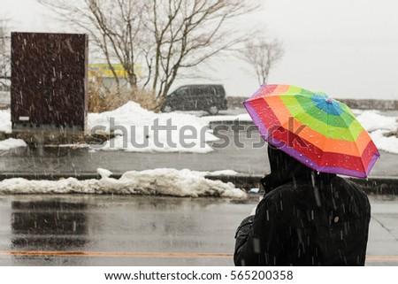 Stock Photo The umbrella when it snows