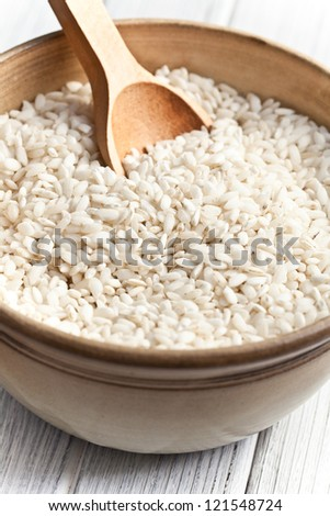 the uncooked arborio rice in bowl