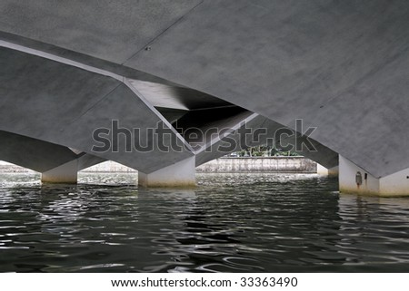 The underside of a bridge over the Singapore river in downtown Singapore