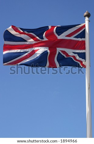 The Union flag (Union Jack) blowing in the wind on a sunny day