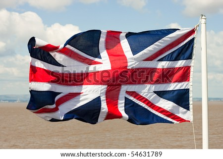 The Union Jack British flag rippled on a windy day at sea