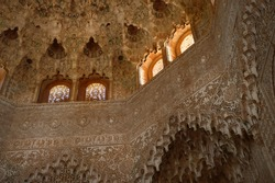 The unique arabic windowns throwing light to the engraved walls of Alhambra