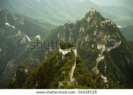 The unique white rock Jiankou section of the Great Wall of China hugs the spine of a mountain.