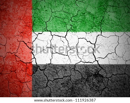 The United Arab Emirates flag painted on cracked ground with vignette