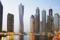 The United Arab Emirates. The Dubai Waterfront. On the banks of the lagoon Dubai are high-rise modern buildings to the waterfront moored a large number of boats .