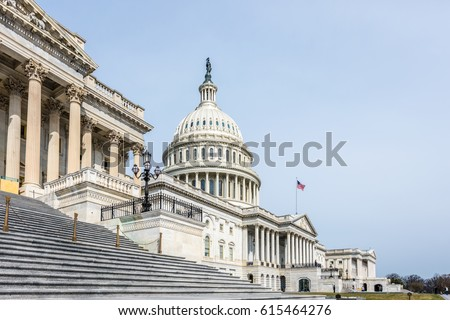The United States Capitol Building in Washington DC stands tall on its so named hill. #615464276
