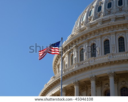 The United States Capitol dome and flag in Washington DC.