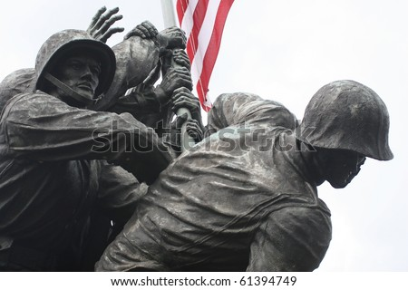 The United States Marine Corps War Memorial in a close-up of the Marines raising the American Flag.  Stark, with the flag lending color to the scene.