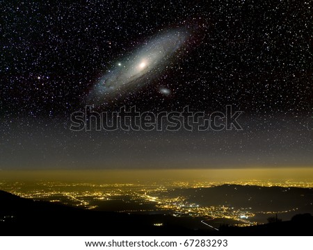The Universe above city lights. The Andromeda galaxy.