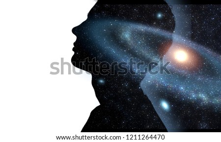 The universe within. Silhouette of a man with the space as a brain. The concept on scientific and philosophical topics.  Elements of this image furnished by NASA. #1211264470