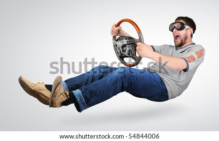 The unreal mad man in goggles with a wheel in hands