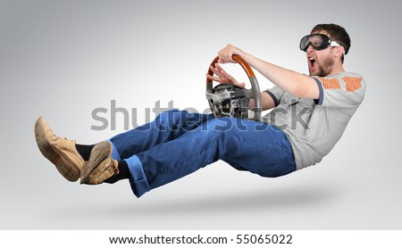 The unreal mad man in goggles with a wheel in hands signals