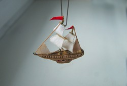 The unusual Christmas-tree decoration in the form of a ship. Beautiful handmade Christmas  papier-mâché decoration. New Year ornaments. Nautical Pendants.