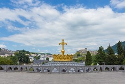 The Upper Basilica with gilded crown ad cross in Lourdes