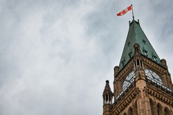 The upper portion of the Peace Tower on Parliament Hill in Ottawa, Canada from a low angle.