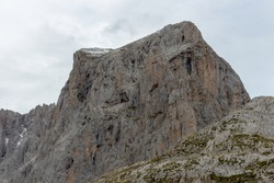 The upper start section of hiking track PR-PNP 24 to the magnificient summits of Mounts Pena Remona, Torre de Salinas, La Padierna and Pico de San Carlos at Picos de Europa National Park, Spain.