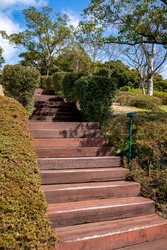 The upstairs lead to the park with plants on the both side.