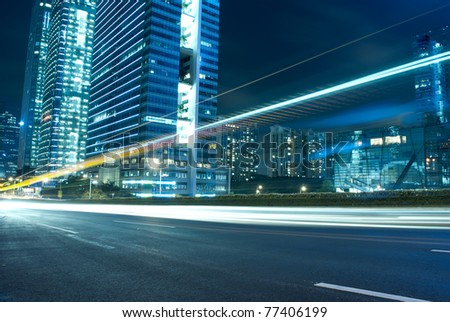 The urban landscape at night and through the city traffic