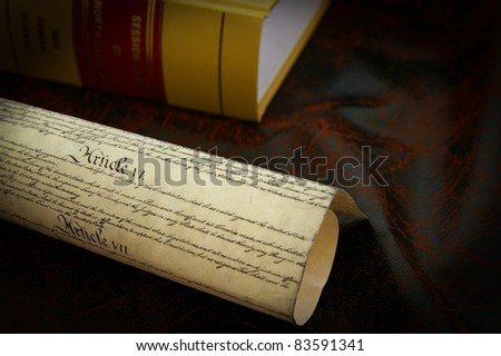 The US Constitution and a law book